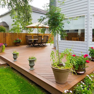 Outdoor Living Spaces Created from Angled Front Deck and Back Decks