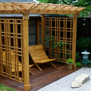 Deck - backyard deck idea in New York with a pergola