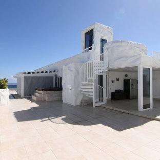 Outdoor kitchen deck - coastal rooftop outdoor kitchen deck idea in Miami