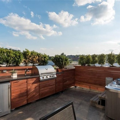 Example of a mid-sized minimalist rooftop outdoor kitchen deck design in Other with no cover