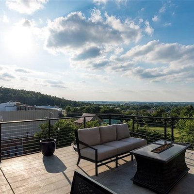 Inspiration for a mid-sized modern rooftop outdoor kitchen deck remodel in Other with no cover