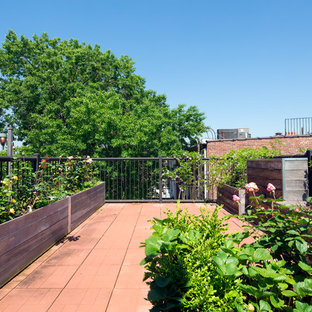 Deck container garden - large traditional rooftop rooftop deck container garden idea in New York with no cover