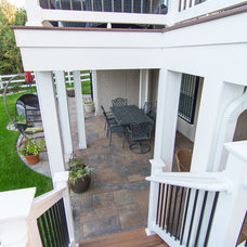 Transitional Patio by The Sharper Cut, Inc. Landscapes