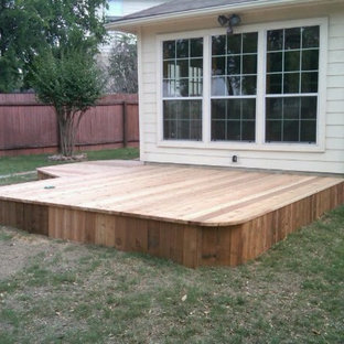 Mid-sized arts and crafts backyard deck in Austin with no cover.