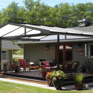 Deck - mid-sized farmhouse deck idea in Seattle