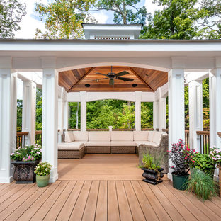 Inspiration for a large timeless backyard mixed material railing deck remodel in New York
