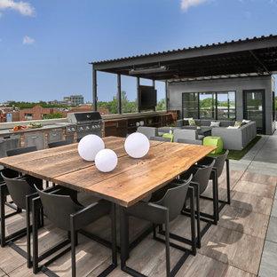 Idéer för att renovera en mycket stor funkis takterrass, med utekök