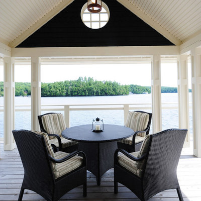 Inspiration for a mid-sized coastal backyard deck remodel in Other with a roof extension