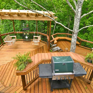 Inspiration for an expansive traditional backyard deck in Other with a pergola.