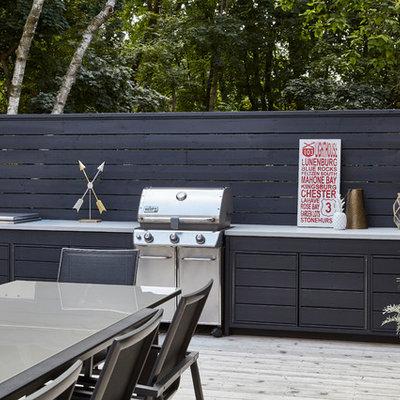 Outdoor kitchen deck - large modern backyard outdoor kitchen deck idea in Toronto with a pergola