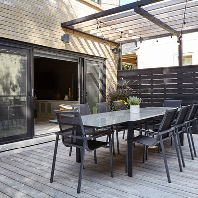 Inspiration for a large modern backyard outdoor kitchen deck remodel in Toronto with a pergola