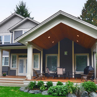 Example of a mid-sized arts and crafts backyard deck design in Vancouver with a roof extension