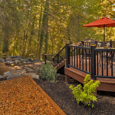 Traditional Deck by Paradise Restored Landscaping & Exterior Design
