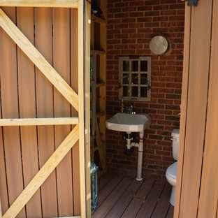 Inspiration for a small beach style backyard deck in Charlotte with an outdoor shower.