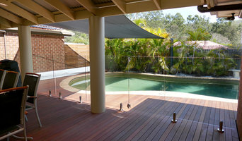 POOL DECK WITH GLASS POOL FENCE