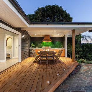 Example of a coastal outdoor kitchen deck design in Melbourne