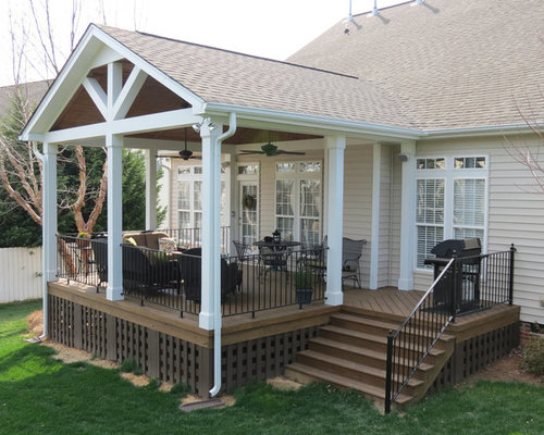 Inspiration For A Mid Sized Contemporary Backyard Deck In Charlotte With Roof Extension