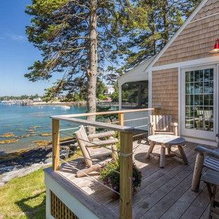 Beach style side yard deck photo in Portland Maine with no cover