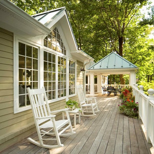 Example of a mid-sized classic backyard deck design in DC Metro with no cover