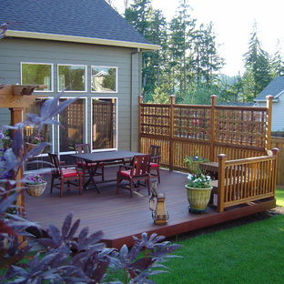 Design ideas for a mid-sized transitional backyard deck in Portland with a vertical garden and a pergola.