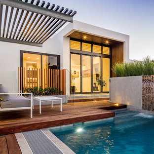 This is an example of a contemporary backyard deck in Perth with a water feature and no cover.