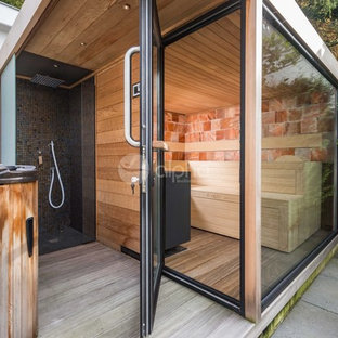 Outdoor shower deck - mid-sized modern backyard outdoor shower deck idea in Los Angeles with a roof extension