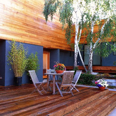 Contemporary Deck by H&M Construction