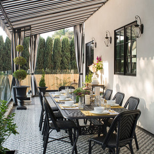 Large transitional backyard outdoor kitchen deck photo in Los Angeles with an awning
