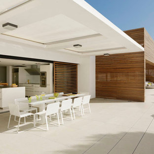 Inspiration for an expansive contemporary deck in Barcelona with a roof extension.