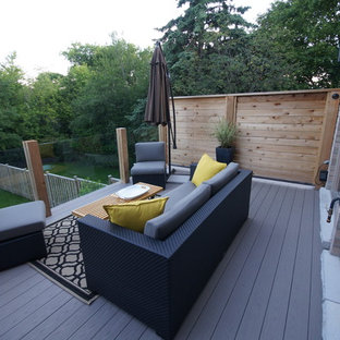 Inspiration for a large modern backyard deck remodel in Toronto with no cover