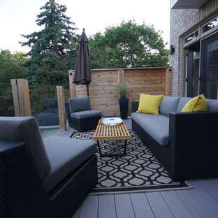 Deck - mid-sized modern backyard deck idea in Toronto with no cover