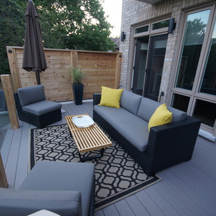 Inspiration for a mid-sized modern backyard deck remodel in Toronto with no cover