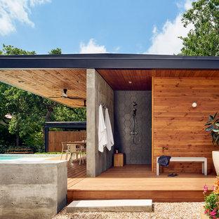 Immagine di terrazze e balconi minimal di medie dimensioni con un tetto a sbalzo
