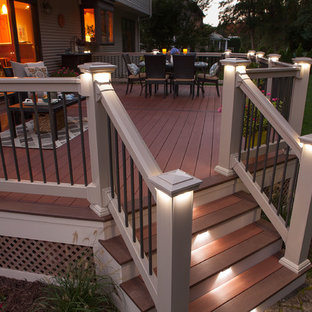Deck - large craftsman backyard deck idea in Boston with a fire pit and no cover