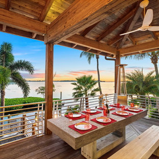 Deck - tropical deck idea in Other with a roof extension