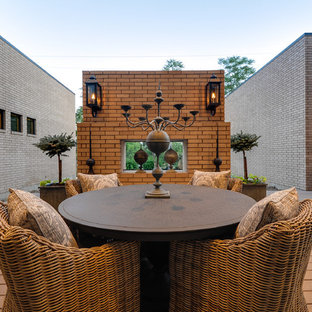 Inspiration for a mid-sized modern backyard deck remodel in Dallas with a roof extension