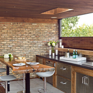 Inspiration for a mid-sized contemporary rooftop outdoor kitchen deck remodel in Chicago with a roof extension