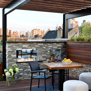 Mid-sized trendy rooftop deck photo in Chicago with a fire pit and a pergola