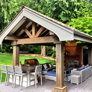 Mid-sized elegant backyard deck photo in Seattle with a fire pit