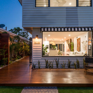 This is an example of a contemporary backyard deck in Gold Coast - Tweed with no cover.