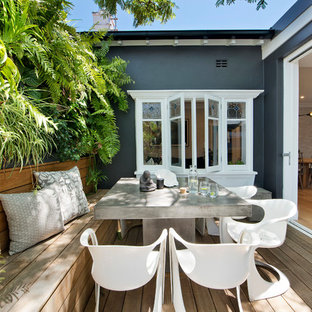 Design ideas for a mid-sized beach style side yard deck in Sydney with a container garden and no cover.