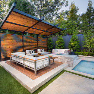 Design ideas for a transitional backyard deck in Dallas with a fire feature and a pergola.