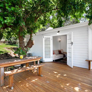 Inspiration for a country backyard deck in Wollongong with no cover.