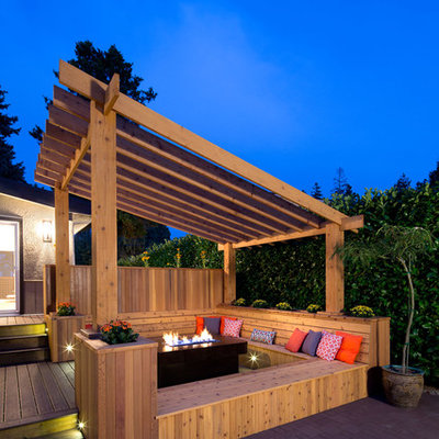 Inspiration for a transitional deck remodel in Vancouver with a fire pit and a pergola