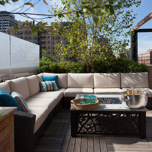 Example of a large trendy rooftop deck design in Chicago with a fire pit and no cover