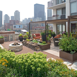 Inspiration for an eclectic rooftop deck remodel in Chicago with a fire pit