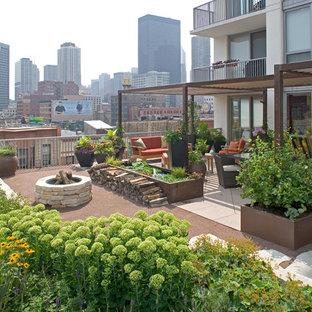 Immagine di terrazze e balconi eclettici sul tetto con un focolare