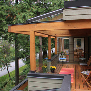 Deck - mid-sized contemporary deck idea in Vancouver with a roof extension