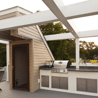 Large contemporary rooftop and rooftop deck in Baltimore with an outdoor kitchen and a pergola.