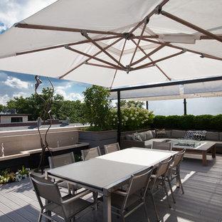 Foto di una terrazza contemporanea di medie dimensioni e sul tetto con fontane e una pergola